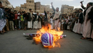 Protesters loyal to the Shi'ite al-Houthi rebel group burn an effigy of a U.S. aircraft during a demonstration in Yemen