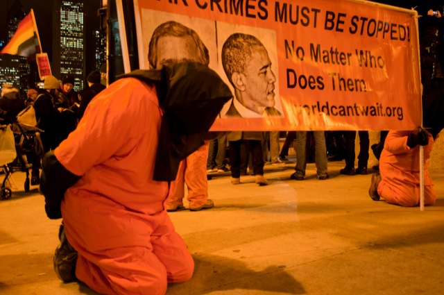 Activists are dressed up as prisoners to protest American torture in Chicago on Dec.10, 2014. Around 200 anti-violence activists held a peaceful assembly on the International Human Rights Day in Chicago. Some of them protested against the grand jury decisions in the death of Michael Brown in Fugerson, Missouri and also chokehold death of Eric Garner in New York. Other activists also blamed U.S. involvement in the Middle East, protested the U.S. torture used by the CIA revealed in a Tuesday's report since the Sept. 11, 2001 terror attack. (Xinhua/He Xianfeng) XINHUA /LANDOV