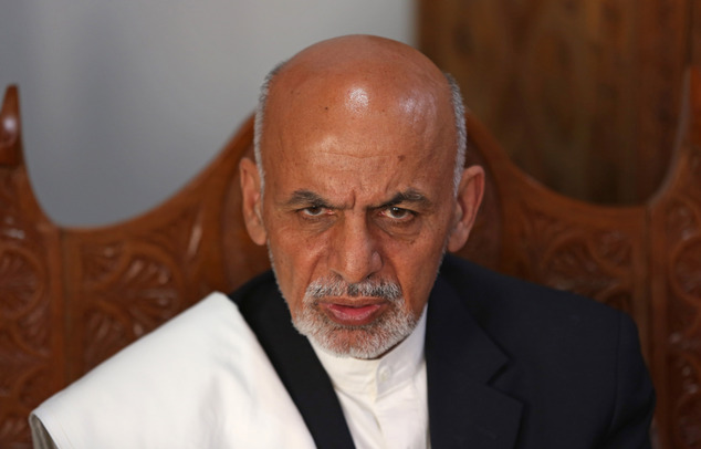 Afghan presidential candidate Ashraf Ghani Ahmadzai talks during an interview with The Associated Press at his resident in Kabul, Afghanistan, Thursday, April 3, 2014. A leading Afghan presidential candidate praised Hamid Karzai for allowing the country's first democratic transition of power and said he'll offer the longtime leader an advisory role if he wins. (AP Photo/Massoud Hossaini)